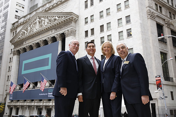 (left to right) Hewlett Packard Enterprise's Chief Financial Officer Tim Stonesifer, Chief Operating Officer Chris Hsu, President and Chief Executive Officer Meg Whitman, and Chief Marketing and Communications Officer Henry Gomez outside the New York Stock Exchange. CREDIT: Eric Draper